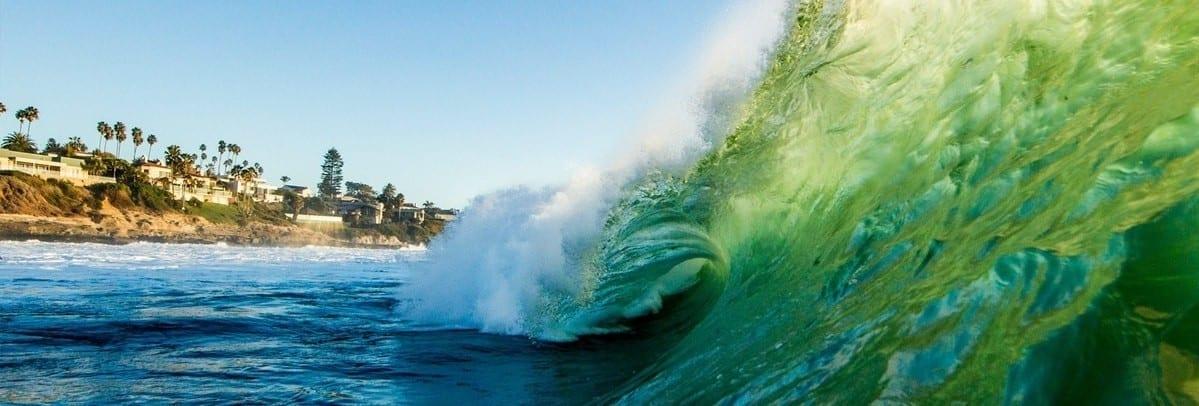 Surfers wave