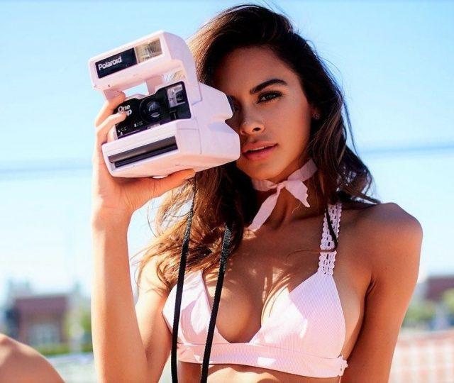 Sophia Miacova posing in a pink bikini